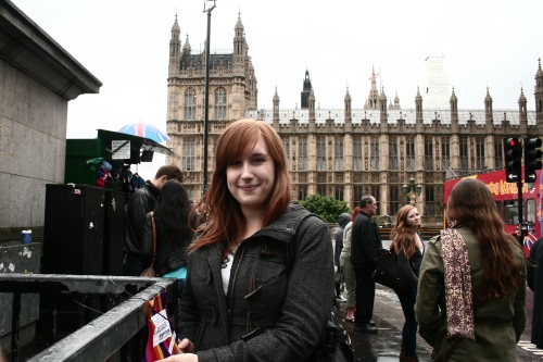 Josie with the mini protest banner in front of Westminster