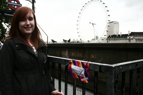 Josie with the mini protest banner with the London Eye in the background
